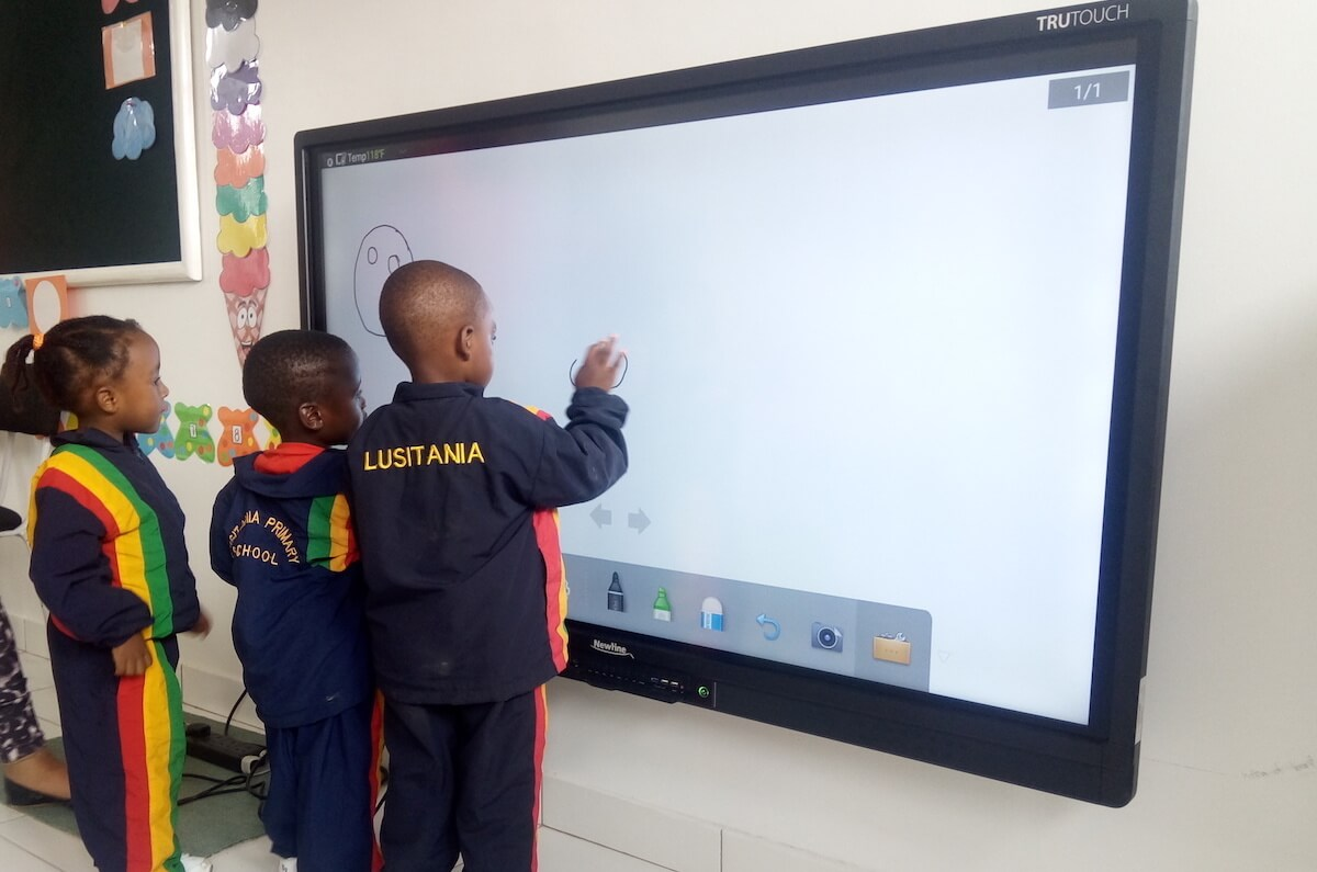 multiple students interacting in classroom display