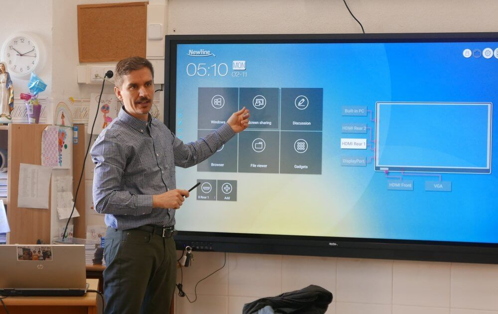 person speaking in class on interactive display