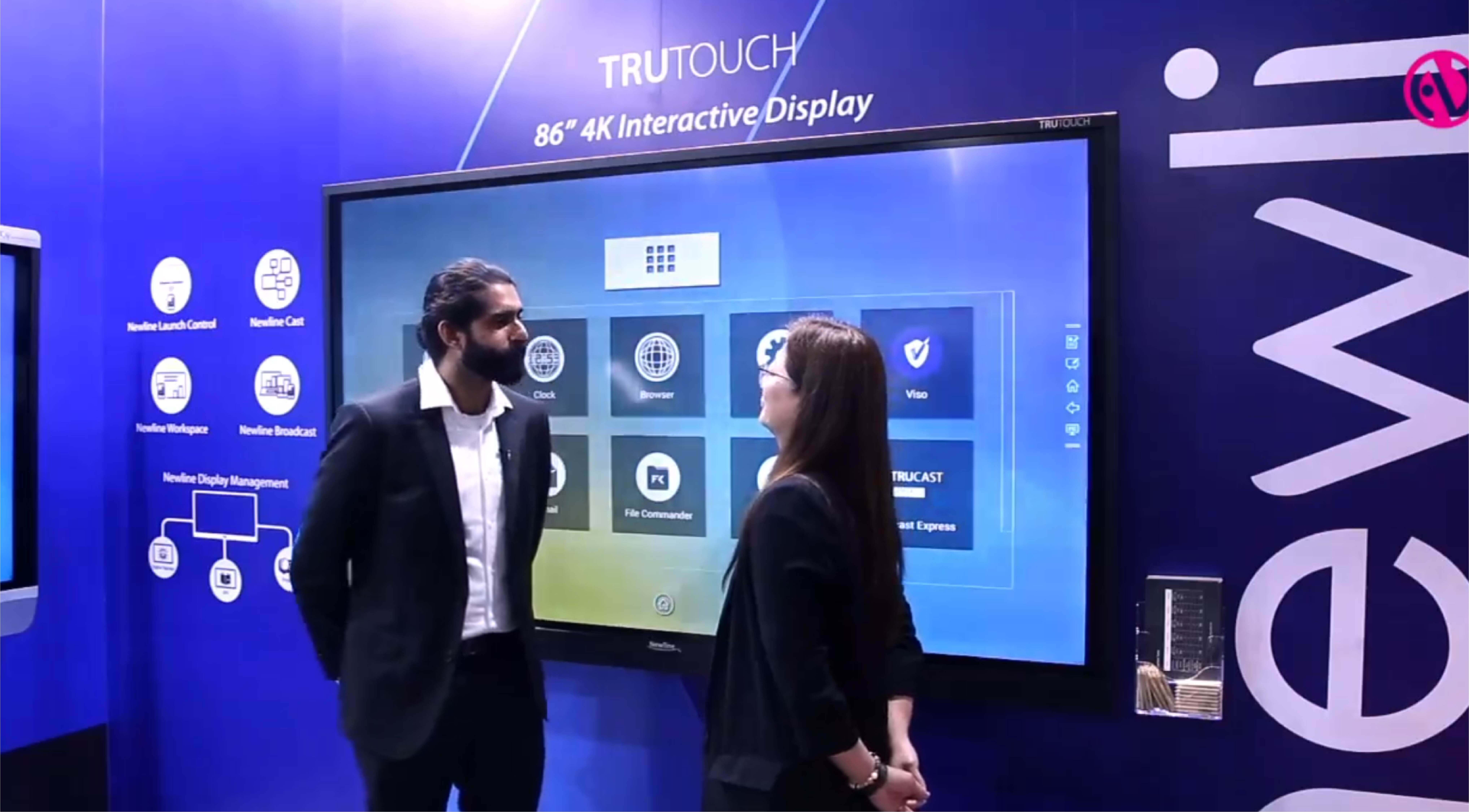 people interacting on touch screen