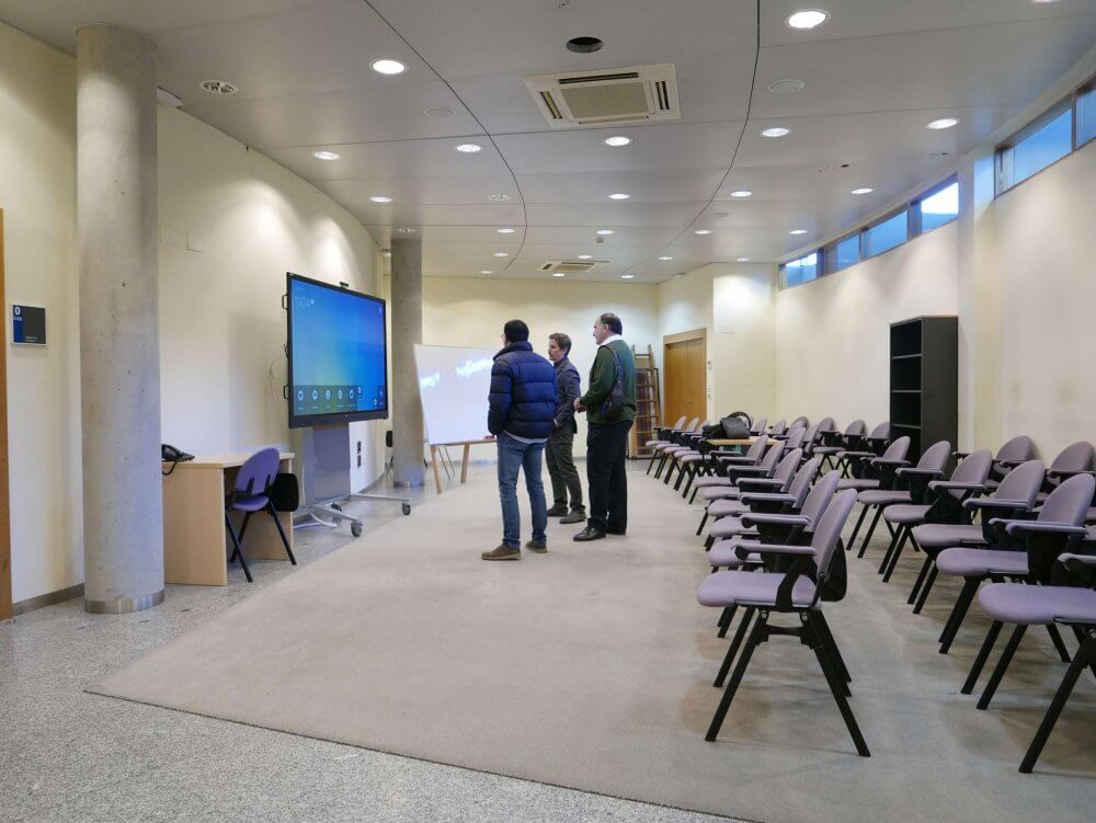 people collaborating on interactive display