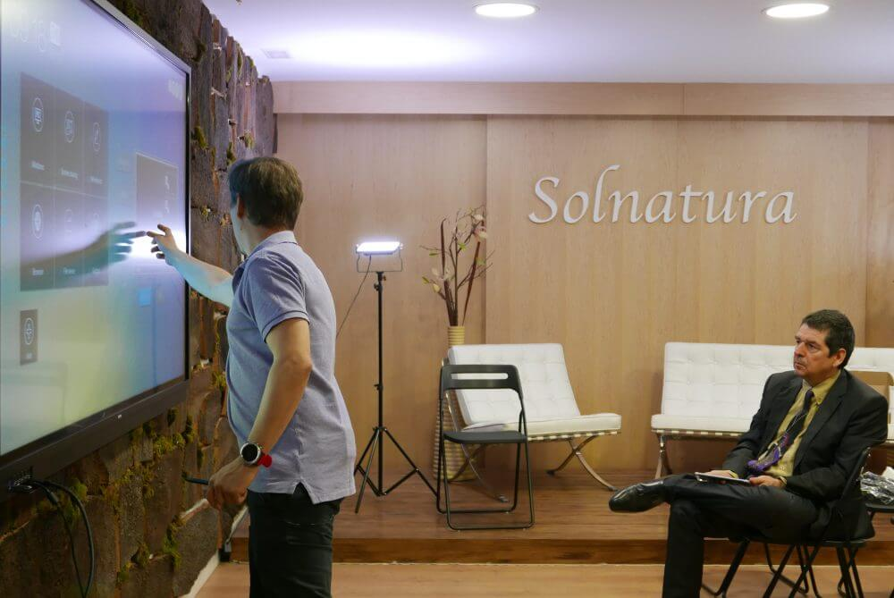 Solnaturaleza: person giving presentation with interactive display