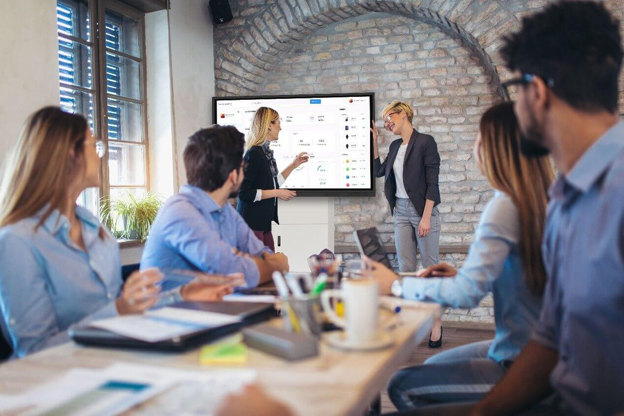 people interacting on touch screen during meeting